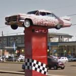 1959 Pink Cadillac on a sign pole