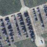 Closed Soviet Air Base with new cars stored on the former runway (Google Maps)
