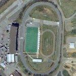 Football field inside of a race track