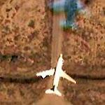 Airplane in flight over Baghdad (Google Maps)