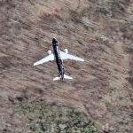Airplane over woods (Google Maps)