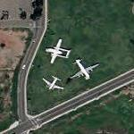 Three airplanes on static display (Google Maps)