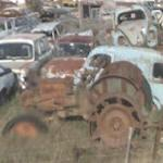 Old tractor & VW Beetle at a wrecking yard