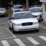Police car in handicapped parking space