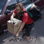 Man Transporting Box on Bicycle (StreetView)