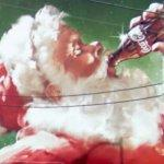 Santa on a Coca Cola billboard