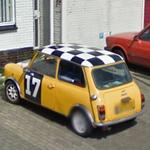 Old Mini with checkered flag on top