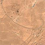 A line of bomb craters in desert near Al Taqadudum (Google Maps)