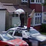 Sculpture atop a Police Car