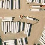 Windmill towers and trucks (Google Maps)