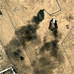 Flame and shadow from burning off natural gas at Iraqi refinery