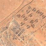 Destroyed Barracks, Bunkers with Vehicles and Debris Strewn Everywhere (Google Maps)