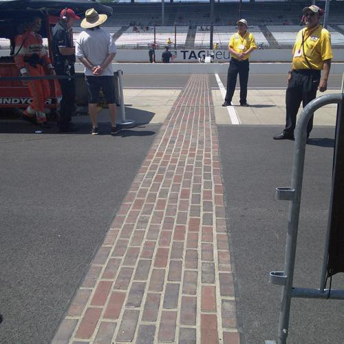 Indy's yard of bricks extends across the racing surface and into the infield.