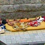 Guy sleeping on the sidewalk