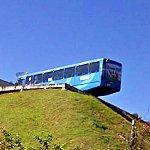 Bus overhangs on steep hill (StreetView)