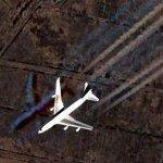 Boeing 747 with contrails (Google Maps)