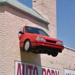 Car mounted on a wall (StreetView)