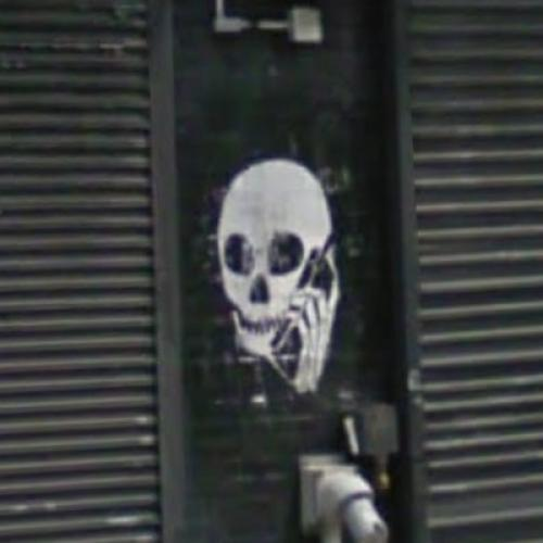 Skull with cell phone graffiti by Spazmat (StreetView)