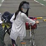 Cyclist wearing a face mask (StreetView)