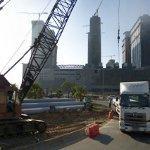 Crane unloading some piles