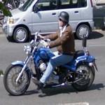 Motorcycle rider wearing German Stahlhelm (StreetView)