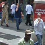 Three men on cellphones (StreetView)