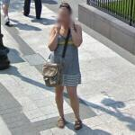 Woman with a cellphone (StreetView)