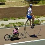Nicky Armstrong riding a penny farthing (StreetView)