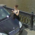 Woman using a cell phone (StreetView)