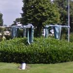Planking sculptures in a roundabout