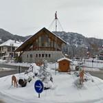 Hut, deer and Santa on a pole in a roundabout (StreetView)