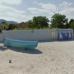 Boat and mural in roundabout (StreetView)