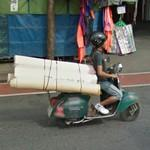 Driving with rolls on a scooter (StreetView)