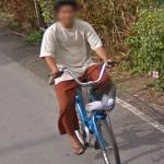 Man on Blue Bike (StreetView)