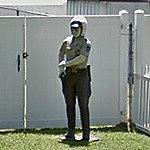 Motorcycle cop sculpture in yard (StreetView)