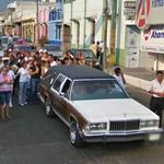 Funeral procession with a hearse