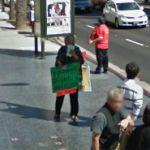 Holding a sign (StreetView)