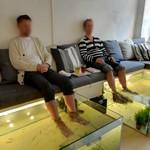 Feet in fish tanks (StreetView)