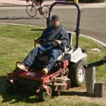 Man on a riding lawn mower (StreetView)