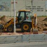Backhoe digging (StreetView)