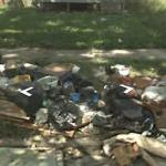 Excessive Trash In Front Of A Vacant House
