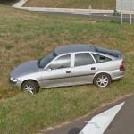 Car in ditch, shattered window (StreetView)