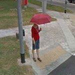 Woman with an umbrella (StreetView)