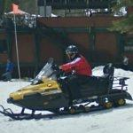 Person on a snowmobile (StreetView)