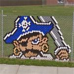 Chain link fence art (StreetView)