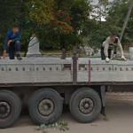 Men in a truck bed (StreetView)