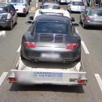 Porsche in tow