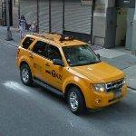 Yellow Ford Escape Taxi