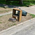 Broken Television In The Trash