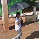 Person with an open umbrella